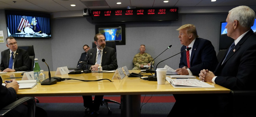 President Trump, second from right, speaks during a teleconference with governors at the Federal Emergency Management Agency headquarters, Thursday, March 19.