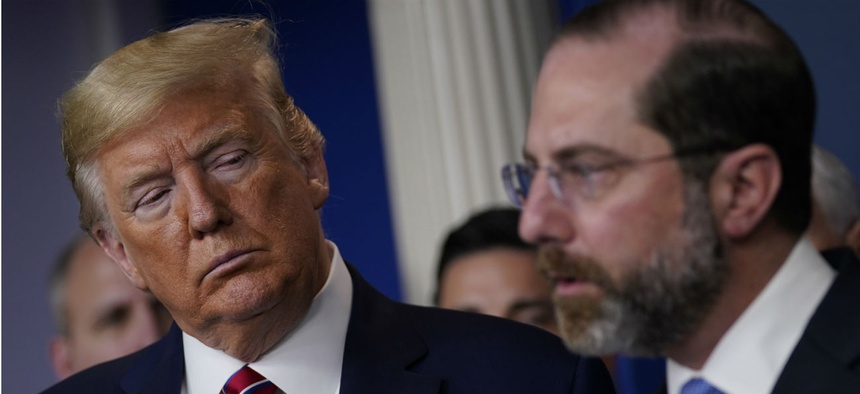 President Trump listens as Department of Health and Human Services Secretary Alex Azar speaks during a coronavirus task force briefing at the White House on March 20.