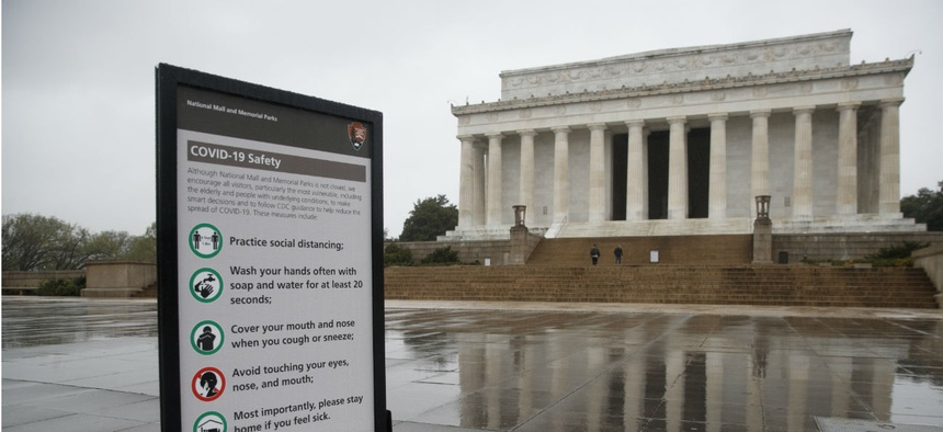 A sign about COVID-19 safely is posted at the Lincoln Memorial in Washington on Monday, March 23.