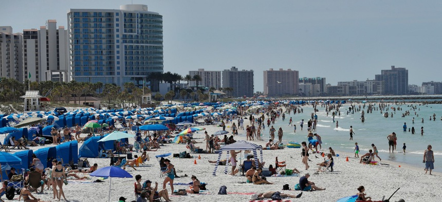 Visitors gather at Florida's Clearwater Beach on March 18.