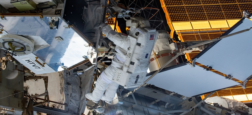 Spacewalker and NASA astronaut Christina Koch retrieves hardware from a pallet delivered on the Japan Aerospace Exploration Agency's HTV-7 to continue upgrading the International Space Station's power storage capacity in 2019.