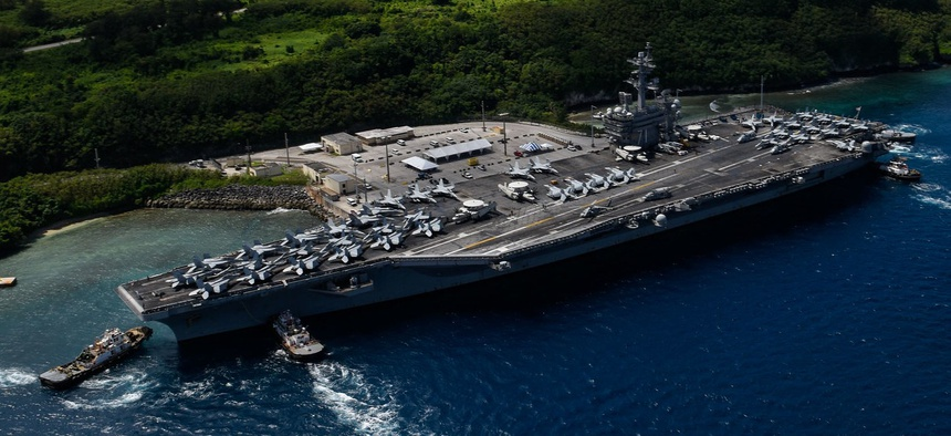 The aircraft carrier USS Roosevelt departs Guam in November 2017.