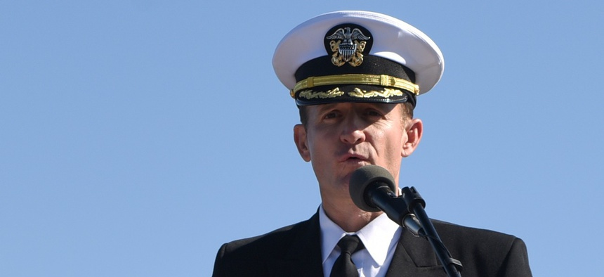 Capt. Brett Crozier addresses the crew for the first time as commanding officer of the aircraft carrier USS Theodore Roosevelt during a change of command ceremony on the ship's flight deck in November 2019.