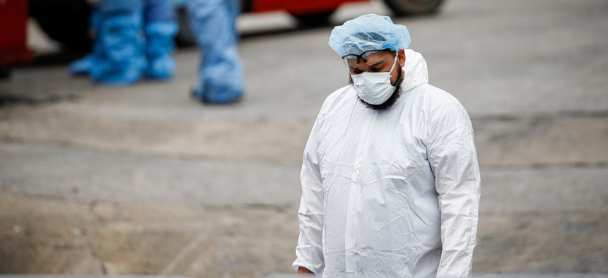 A medical worker wearing personal protective equipment in New York on March 31.