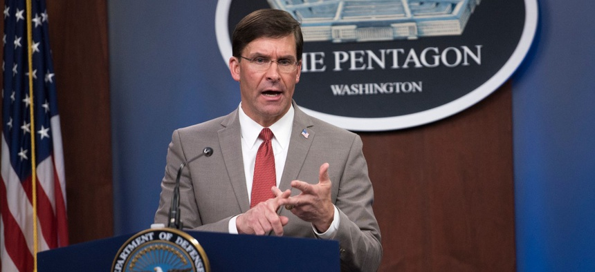 Defense Secretary Mark Esper delivers a coronavirus briefing in March.