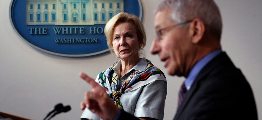 Dr. Anthony Fauci, director of the National Institute of Allergy and Infectious Diseases, speaks about the novel coronavirus Thursday as Dr. Deborah Birx, White House coronavirus response coordinator, listens.