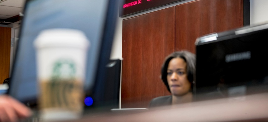 Digital clocks from different time zones around the world are displayed above Drug Enforcement Administration agents and intelligence analysts gathering information from field operations nationwide at their command center on March 11.