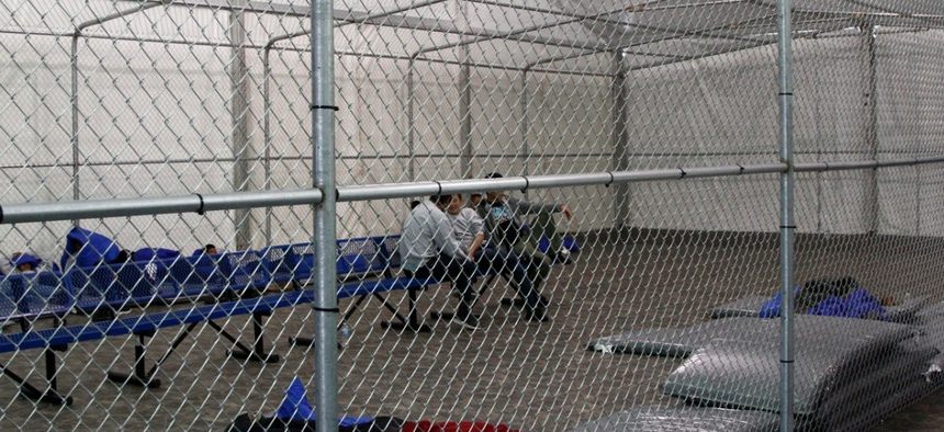 Migrants are detained in a tented, air-conditioned cage at a Border Patrol detention facility in Tornillo, Texas in 2019.