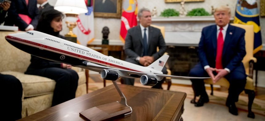 A model of the new Air Force One design sits on a table as President Trump meets with Colombian President Ivan Duque, second from right, in the Oval Office on March 2.