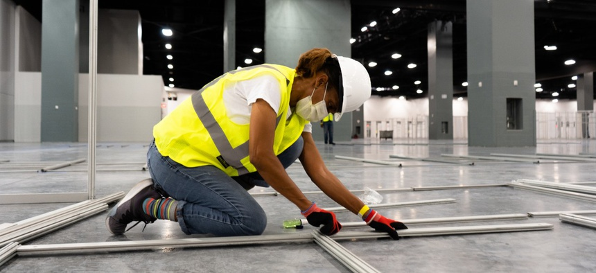 The Miami Beach Convention Center is now a 24-hour construction site, with crews working at a steady pace to install ICU and acute care pods.