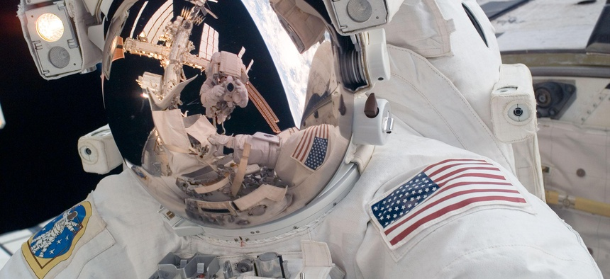 STS-124 Mission Specialist Mike Fossum participates in the mission's first spacewalk in 2008.