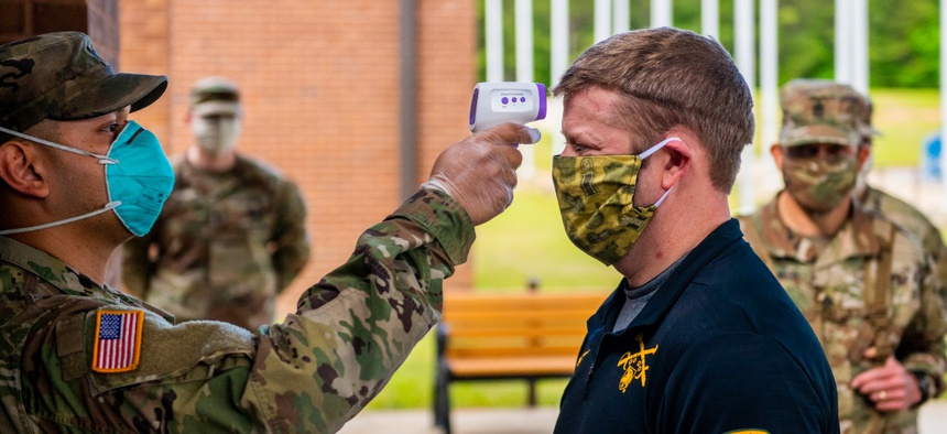Secretary of the Army Ryan McCarthy has his temperature taken at 30th Adjutant Battalion (Reception) during his visit to the Maneuver Center of Excellence April 29.