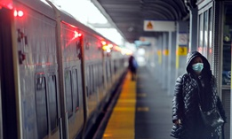 A commuter exits the train in the Queens borough of New York on April 29.
