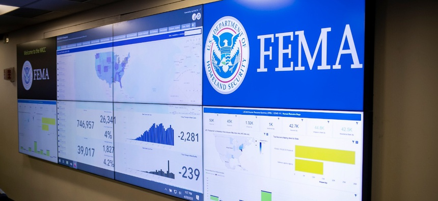 A screen shows information about the novel coronavirus at the Federal Emergency Management Agency headquarters on April 20.