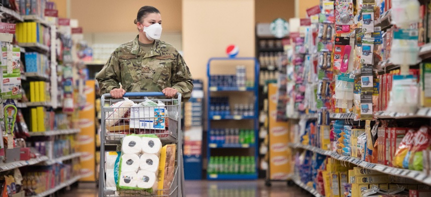 Staff Sgt. Alexandra Haytasingh, 944th Security Forces Squadron fire team leader, shops for groceries on April 16 in the Commissary at Luke Air Force Base, Ariz.
