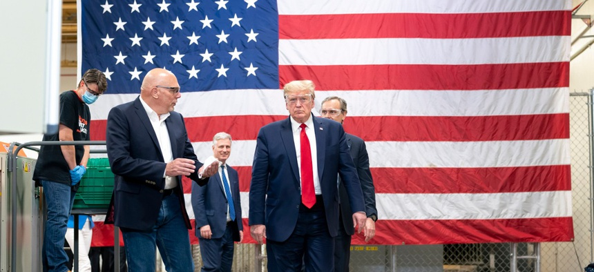 President Trump tours the mask production assembly line Tuesday, May 5, at Honeywell International Inc. in Phoenix.
