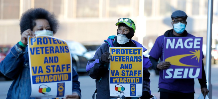 A small group of activists from the American Federation of Government Employees local 424 and the National Association of Government Employees local R3-19 outside the Baltimore VA Medical Center April 22.