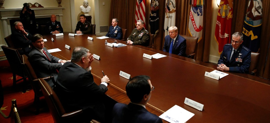President Trump meets with senior military leaders and members of his national security team in the Cabinet Room of the White House on May 9.