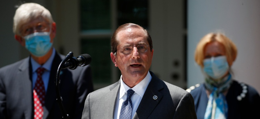 Health and Human Services Secretary Alex Azar speaks about the coronavirus in the Rose Garden of the White House on Friday.