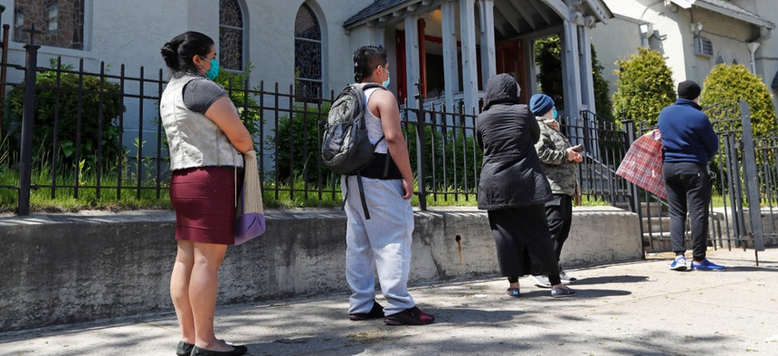 People form a line while waiting to pick up donated groceries from the Brooklyn Immigrant Community Support mutual aid program at Lutheran Church of the Good Shepherd in the Bay Ridge neighborhood of Brooklyn on May 12.