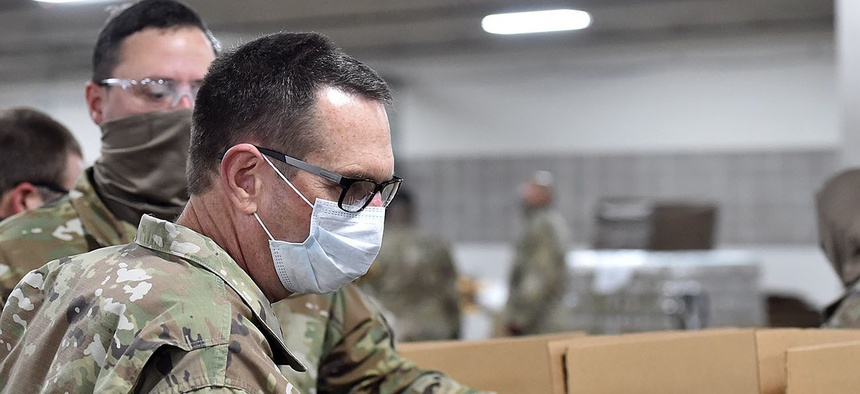 Gen. Joseph Lengyel, chief of the National Guard Bureau, visits the Greater Baton Rouge Food Bank where Louisiana National Guard soldiers are preparing food boxes for distribution in the local area on April 23.