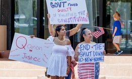 Protesters demanding Florida businesses and government reopen, stand in Fort Lauderdale in May.