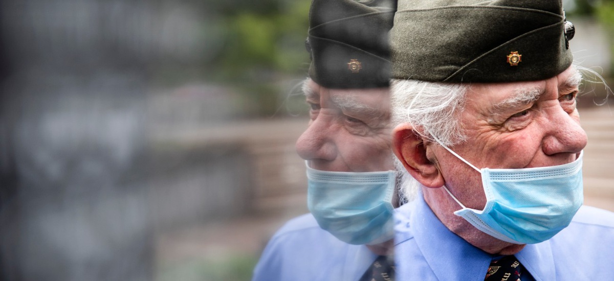 Americans are slowly returning to work and public places, despite the ongoing pandemic. Above, Marine Corps veteran John Kline pays his respects at the Korean War Memorial in Philadelphia on Memorial Day.
