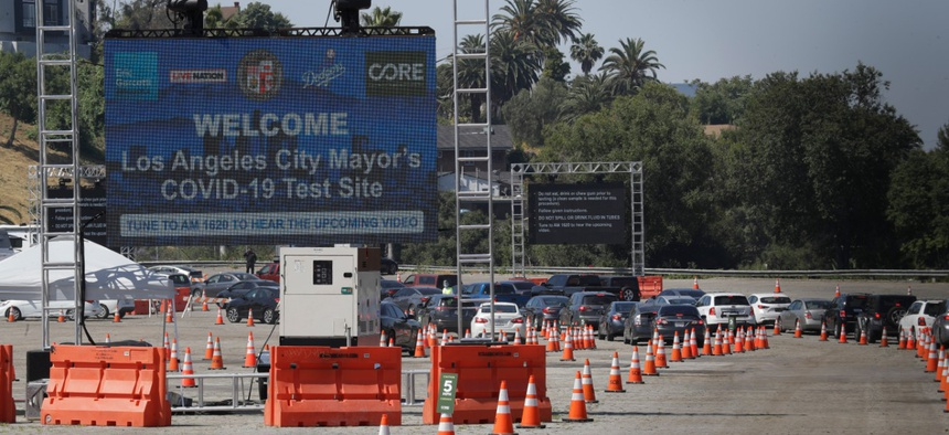 Motorists line up at a coronavirus testing site set up at Dodger Stadium on May 26 in Los Angeles.