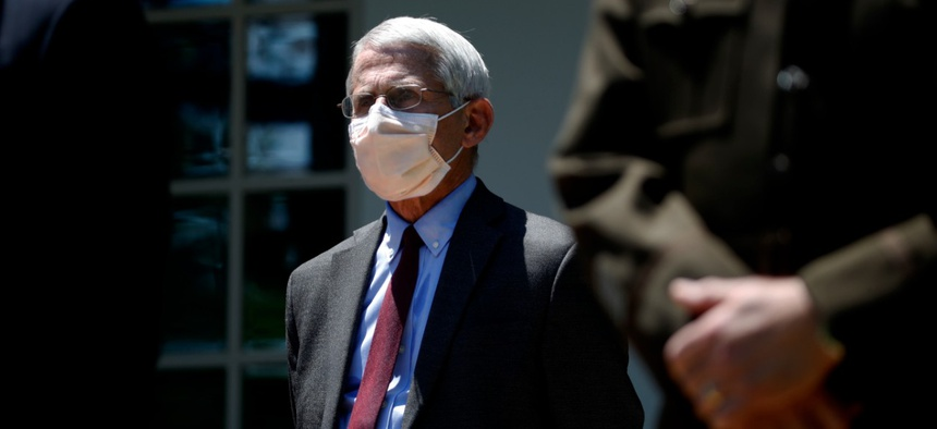 Director of the National Institute of Allergy and Infectious Diseases Dr. Anthony Fauci listens as President Trump speaks about the coronavirus on May 15. Fauci has said a second wave of the virus is not inevitable.
