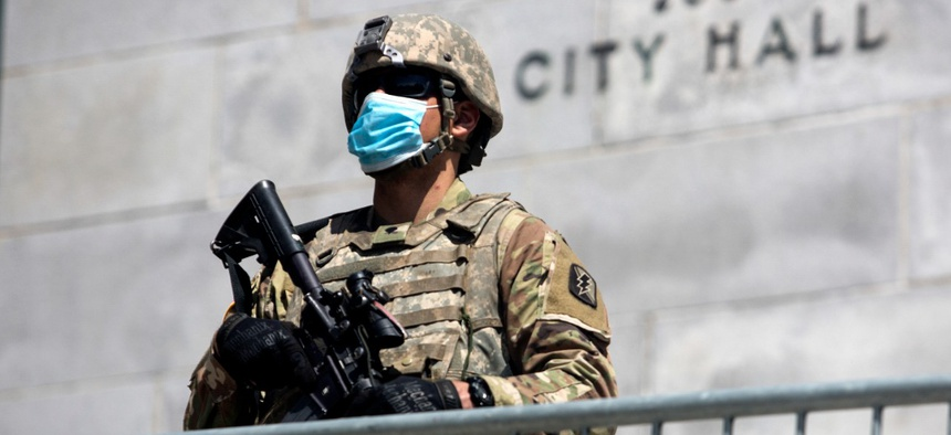 A member of California National Guard stands outside the City Hall on May 31 in Los Angeles.