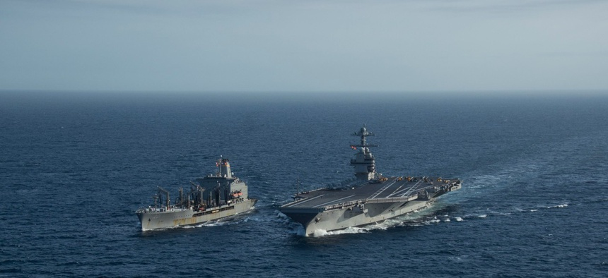 USS Gerald R. Ford (CVN 78) pulls alongside USNS Patuxent (T-AO 201) during a replenishment-at-sea on May 15.