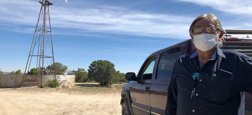 Johnnie Henry, president of the Navajo Nation's Church Rock chapter house community center, hauls drinking water to neighbors in Gallup, N.M., May 7, 2020