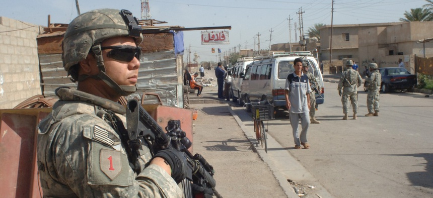 Pvt. Anthony Salazar, Bravo Company, 1st Battalion, 28th Infantry Regiment, 4th Brigade Combat Team, 1st Infantry Division pulls security during a patrol in the Furat area of Baghdad, Iraq on May 8, 2007.