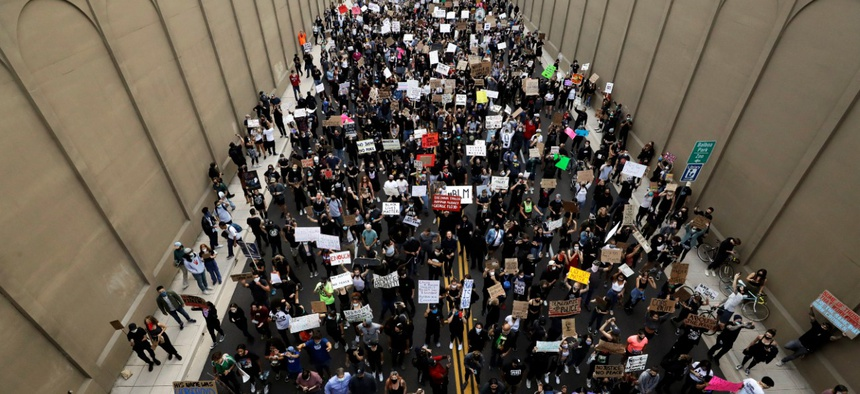 Protesters march Thursday, June 4, 2020, in San Diego. Protests continue in U.S. cities, sparked by the death of George Floyd, a black man who died after being restrained by Minneapolis police officers on May 25.
