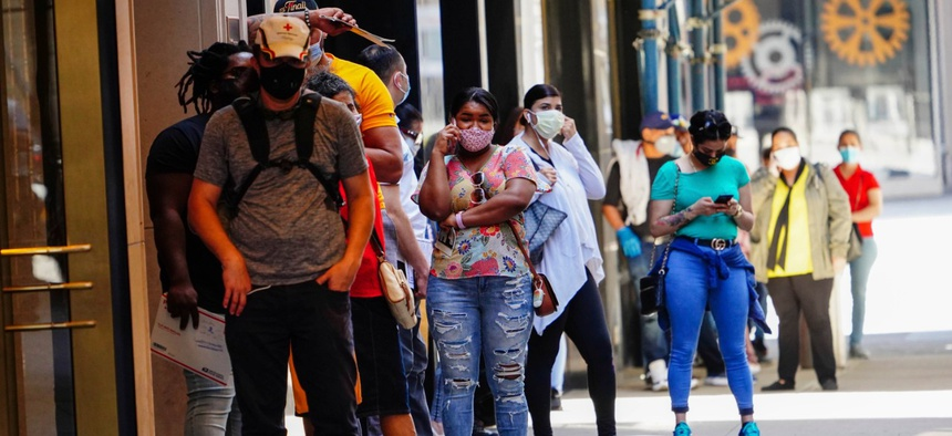 People line up at Paramount Theater Times Square during the coronavirus pandemic on May 27, 2020 in New York City.