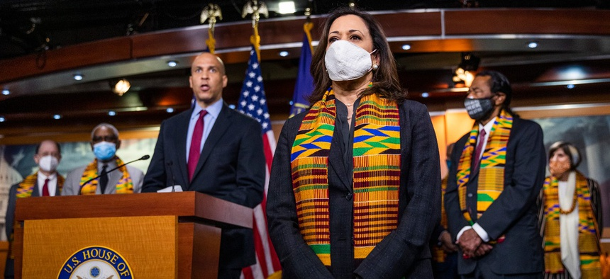 From left, Sens. Cory Booker, D-N.J., and Kamala Harris, D-Calif.; Rep. Al Green, D-Texas, and other congressional Democrats attend a news conference to unveil policing reform and equal justice legislation on Monday.