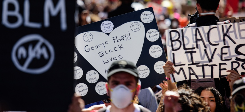Tens of thousands of Americans have taken to the streets to peacefully protest racial inequity in law enforcement. Above, protesters in downtown Miami on May 31.