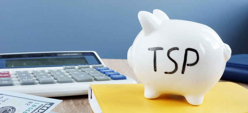 Thrift savings plan TSP written on a piggy bank.