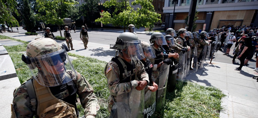 U.S. Army members form a police line on 16th Street as demonstrators gather in Washington, D.C. on June