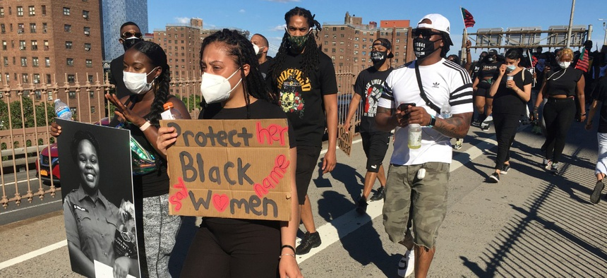 Protesters march across the Brooklyn Bridge and down Broadway to bring attention to the wrongful death of George Floyd at the hands of Minneapolis Police Officers on Saturday.