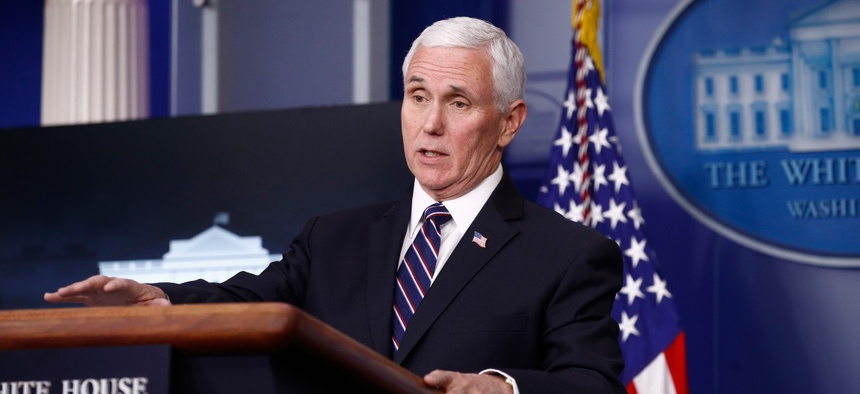 Vice President Mike Pence speaks during a Coronavirus Task Force briefing in April. Pence reportedly told governors on a call on Monday to use the Trump administration's claim that an increase in testing explains the recent coronavirus case spikes.