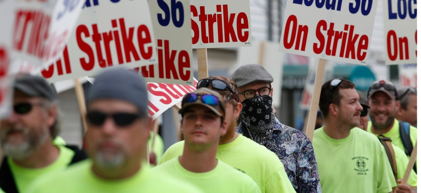 Striking shipbuilders picket outside an entrance to Bath Iron Works in Maine on Monday.