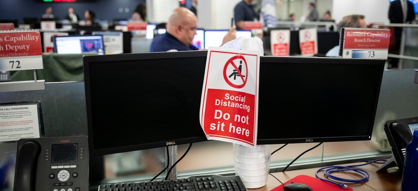 An empty desk shows a sign enforcing social distancing at the Federal Emergency Management Agency headquarters in April.