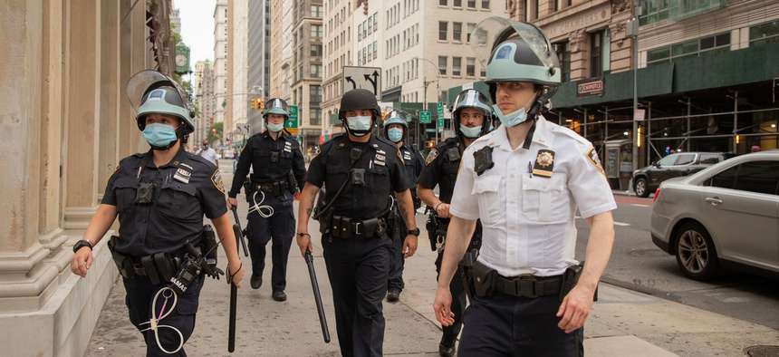 New York City police officers are seen in Lower Manhattan during a demonstration in early June.