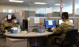Members of the Arizona National Guard conduct exposure notifications from a call center on June 30 as part of contact tracing efforts.