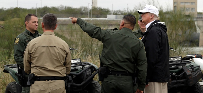 President Donald Trump visiting the U.S.-Mexico border along the Rio Grande in January 2019, not far from where a builder backed by his supporters later erected a border wall.