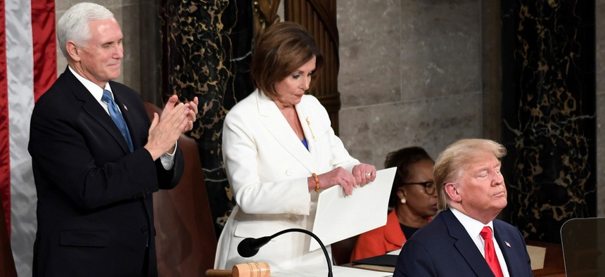 House Speaker Nancy Pelosi, D-Calif., tears her copy of President Trump's State of the Union address after he delivered it to a joint session of Congress on Capitol Hill in Washington, on Feb. 4.