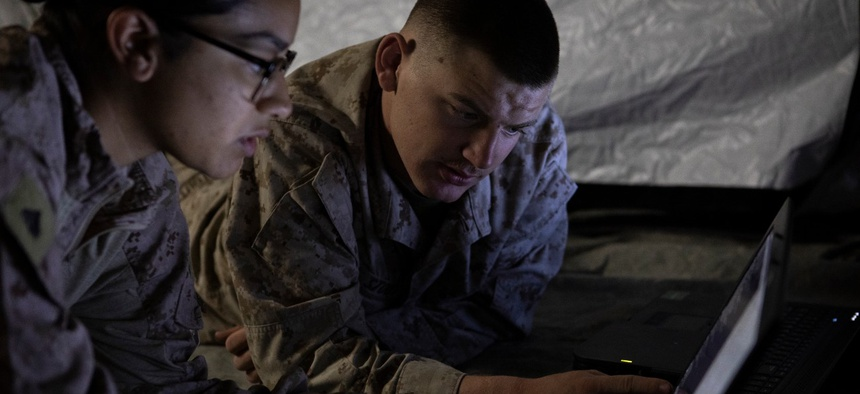 U.S. Marines with the Special Purpose Marine Air Ground Task Force 19.2 Crisis Response Command Element prepare field condition crisis response center networks in Kuwait in August 2019.