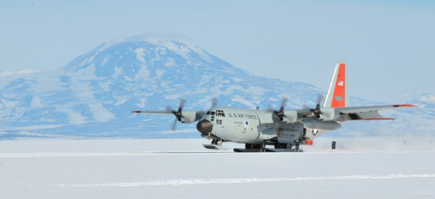 "An LC-130 ""Skibird"" with the 139th Expeditionary Airlift Squadron returns to McMurdo Station, Antarctica, from an IcePod mission in November 2017."