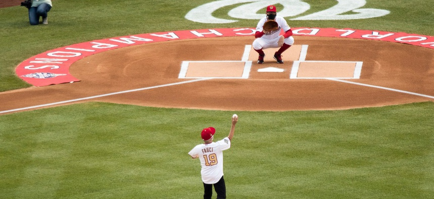 Director of the National Institute of Allergy and Infectious Diseases Dr. Anthony Fauci throws out the ceremonial first pitch at Nationals Park before the New York Yankees and the Washington Nationals play an opening day baseball game Thursday.